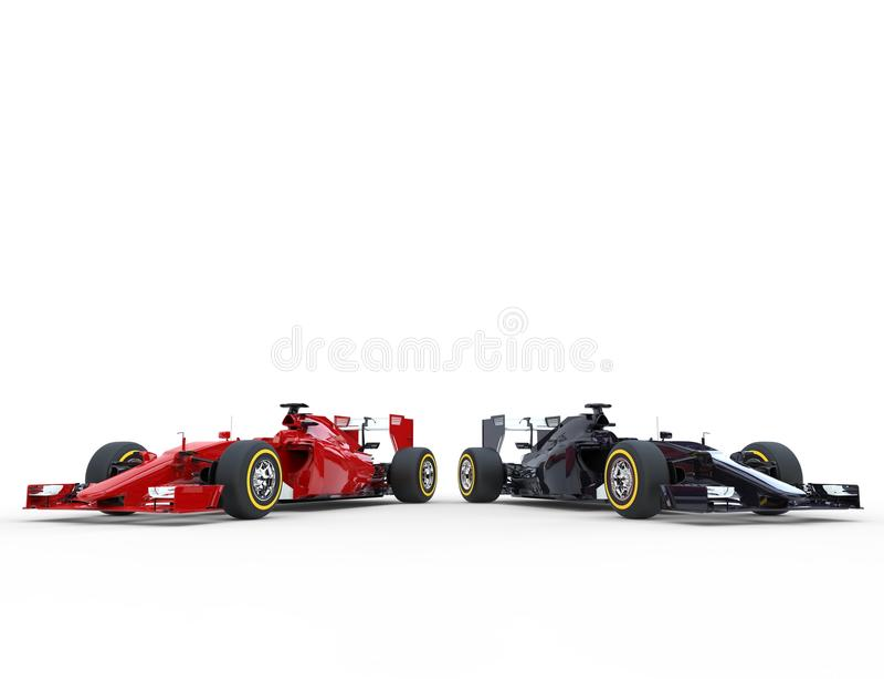 Carros vermelhos e pretos do Fórmula 1 de lado a lado fotografia de stock royalty free