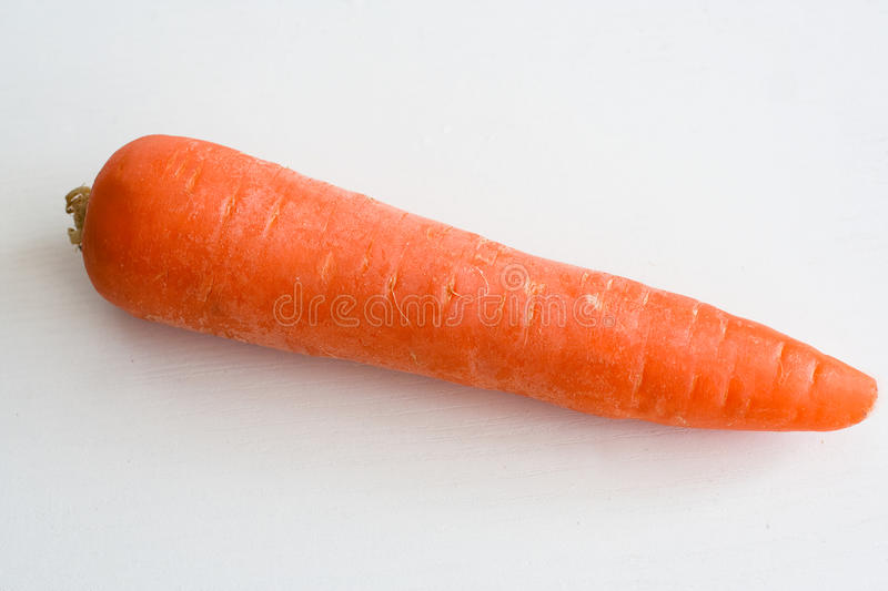 Carrot. Singe carrot isolated on white stock photos