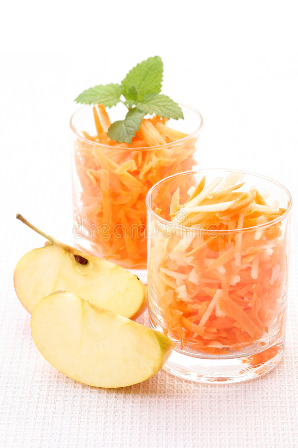 Carrot and apple salad. Two glasses of carrot and apple salad - healthy eating royalty free stock images