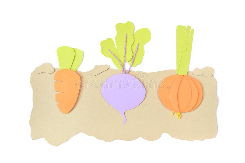 Carrot, beetroot and onion paper cut on white background stock photography