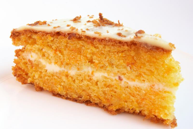Carrot cake. Piece of carrot cake with vanilla cream royalty free stock photography
