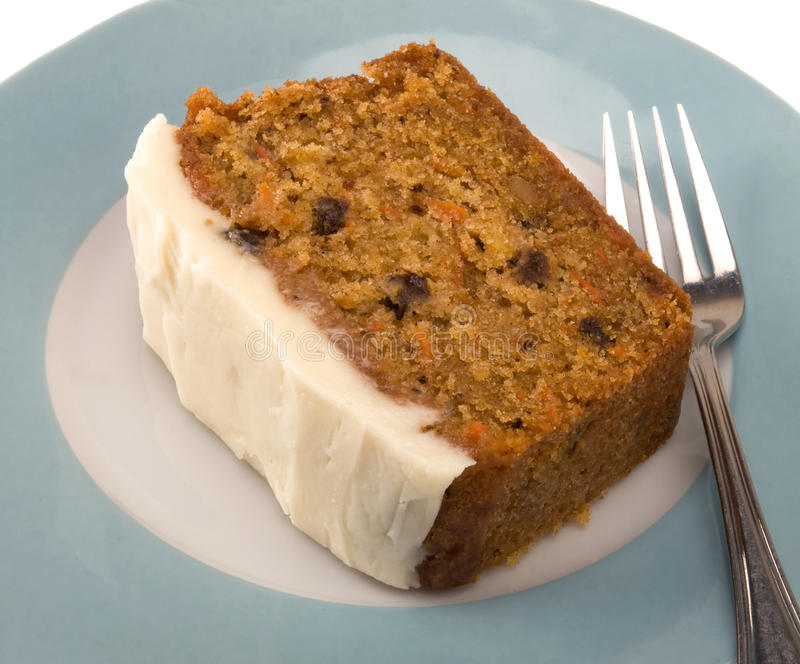 Carrot cake. Slice of carrot cake on turquoise plate with fork royalty free stock photo