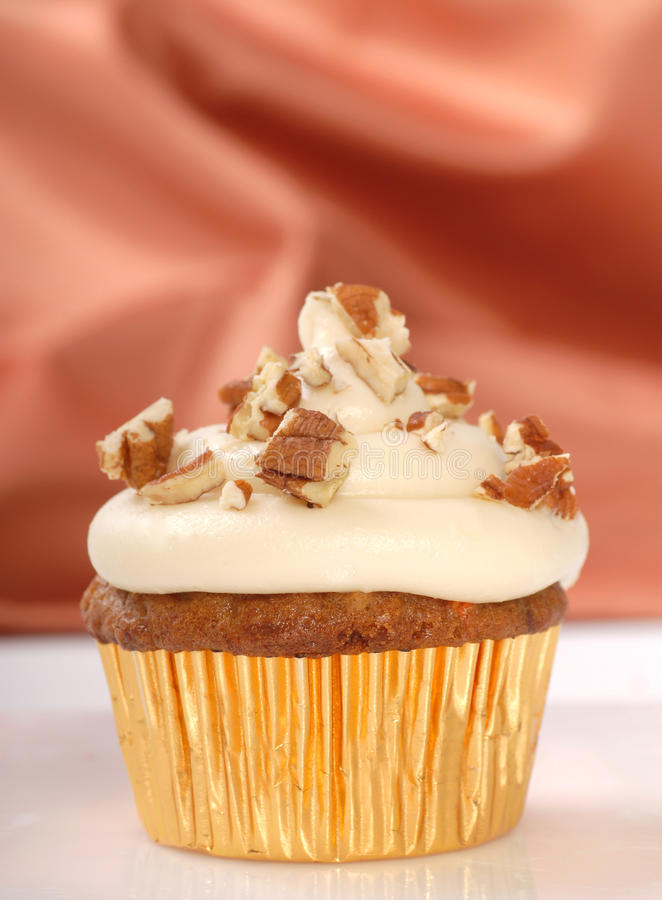 Free Carrot Cake Cupcake With Cream Cheese Frosting Royalty Free Stock Images - 23159459
