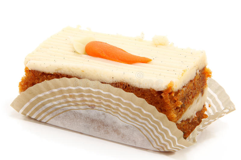 Carrot Cake Slice. Piece of carrot cake on bakery serving paper shot over white royalty free stock photos