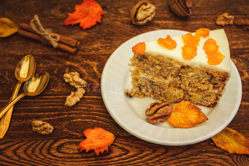 Carrot cake with walnuts on wooden background stock image