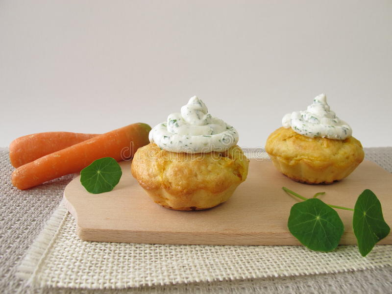 Carrot cupcake with herb cream cheese royalty free stock photos