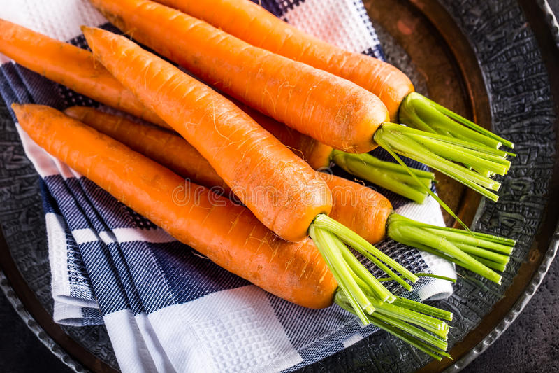 Carrot. Fresh Carrots bunch. Baby carrots. Raw fresh organic orange carrots. Healthy vegan vegetable food royalty free stock images