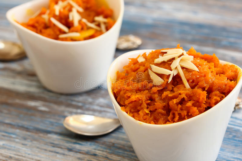 Carrot halwa - Diwali sweet made of carrots milk and sugar. In white bowl stock images