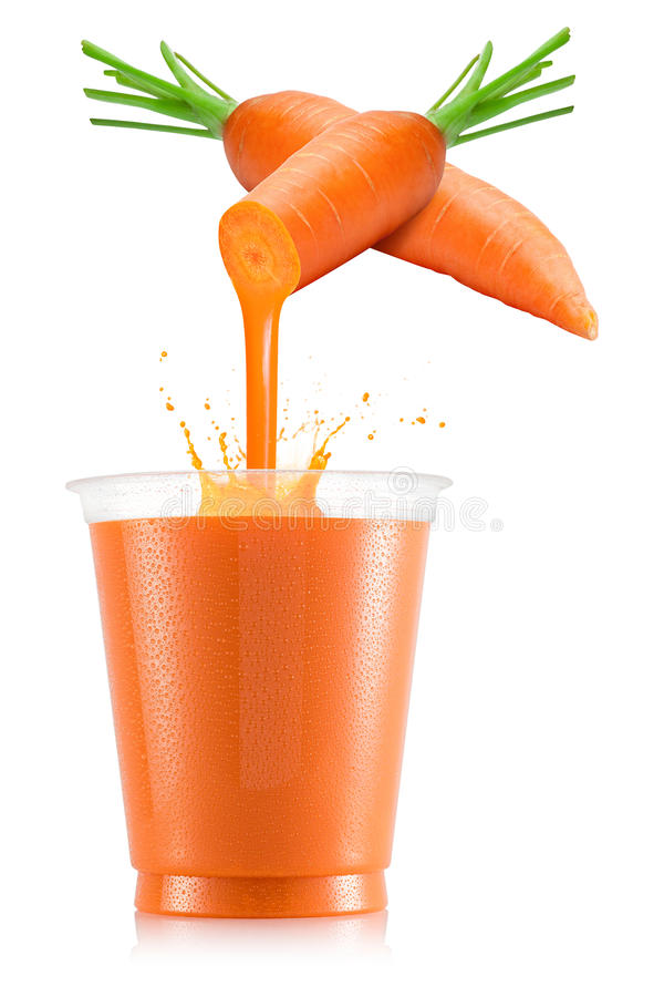 Carrot juice pouring out from fruit into plastic cup. Pure carrot juice pouring out from fruit into plastic cup isolated on white background royalty free stock image