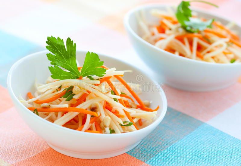 Carrot and kohlrabi salad. On the plate stock images