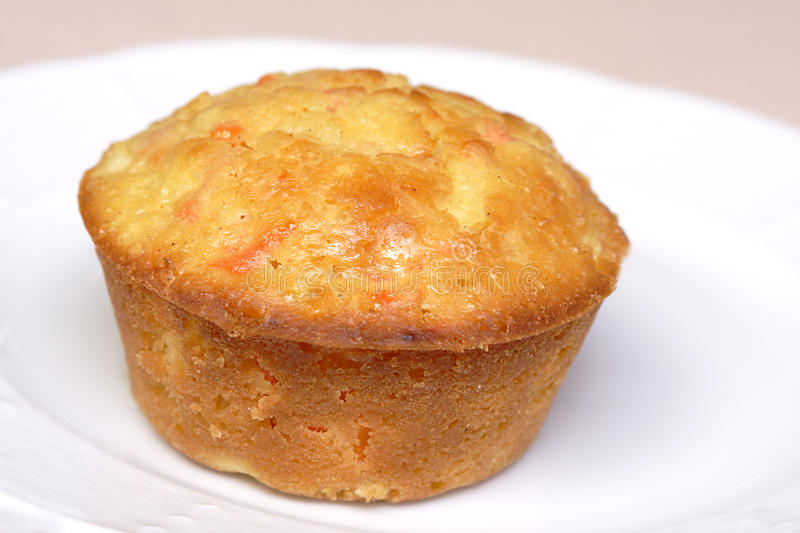 Carrot muffin. Single carrot pineapple muffin on white plate stock images