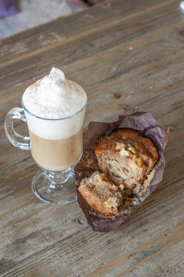 Carrot muffin with vanilla latte stock image