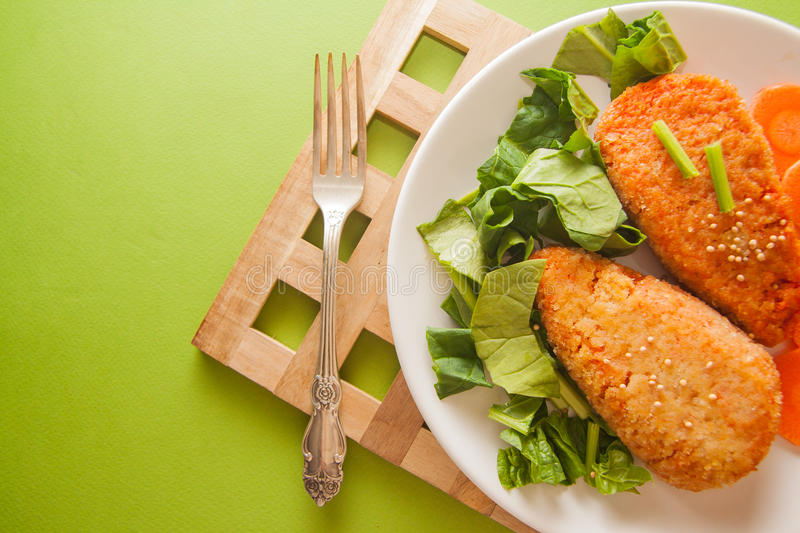 Carrot pancakes with spinach royalty free stock photo