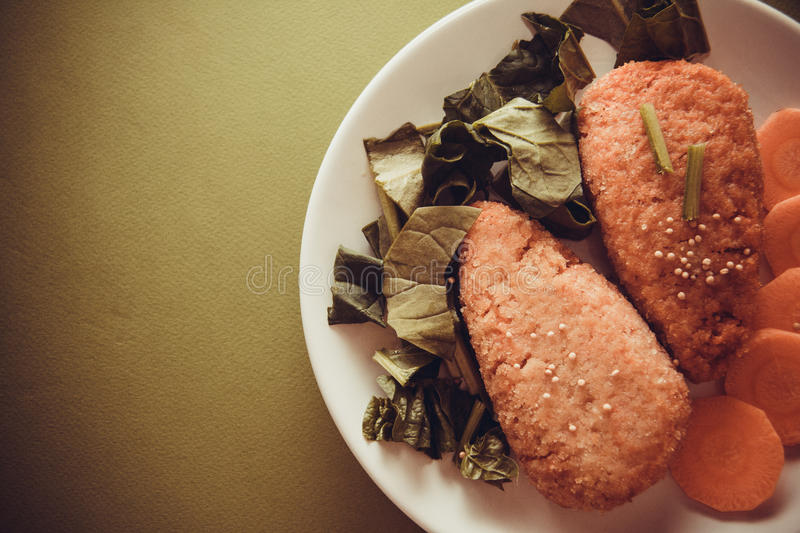 Carrot pancakes with spinach royalty free stock image