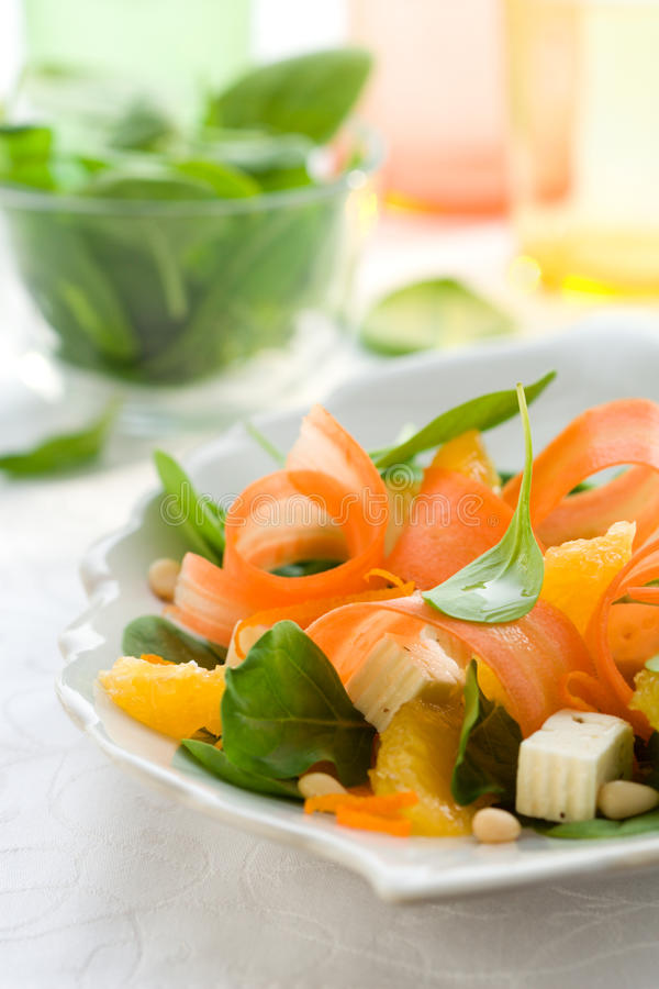 Carrot salad. With spinach, feta and orange royalty free stock photo