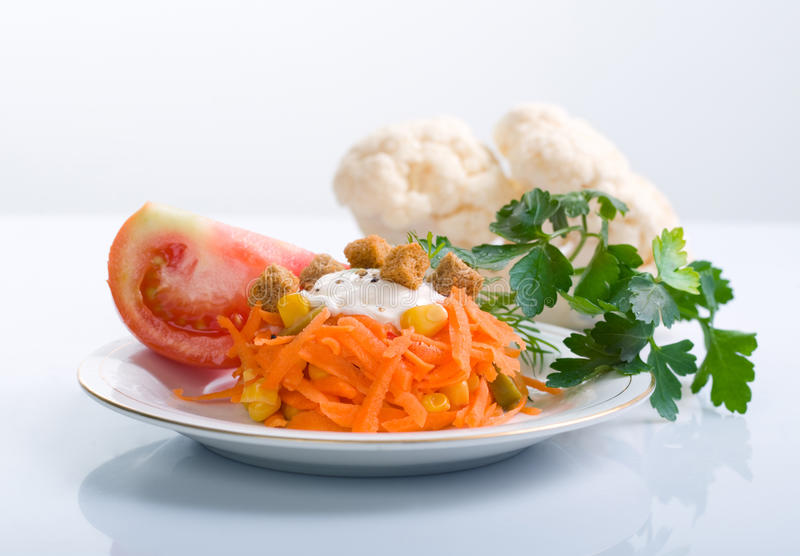 Carrot salad. With tomato and parsley royalty free stock photos