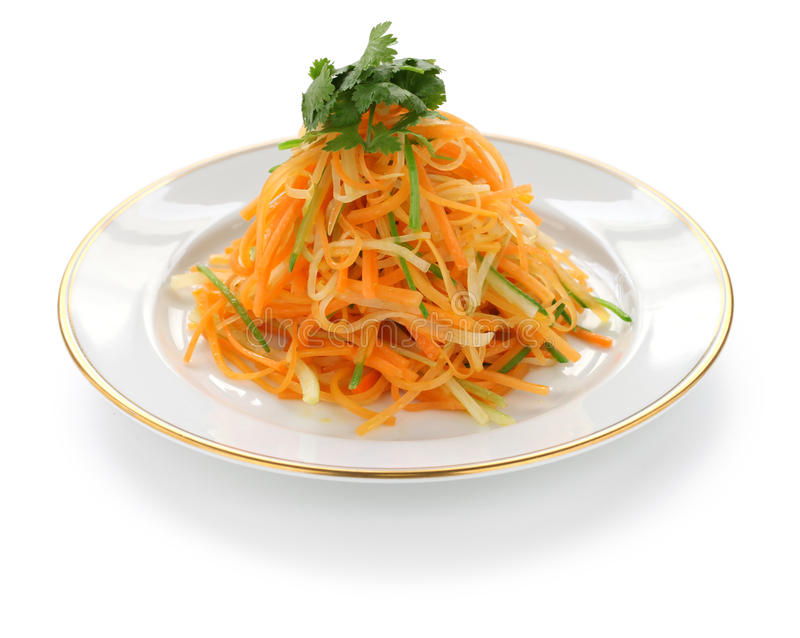 Carrot salad. Shredded carrot salad on a white background stock photos