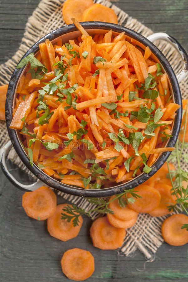 Carrot salad. Healthy and light carrot salad with herbs royalty free stock photography