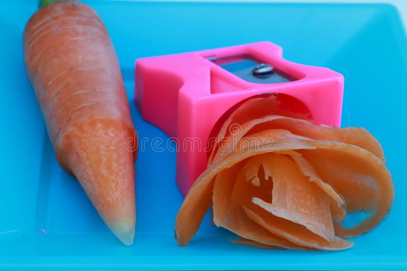 Fresh carrot shavings sharpened with a pencil sharpener. Carrot shavings made with a pencil sharpener royalty free stock images