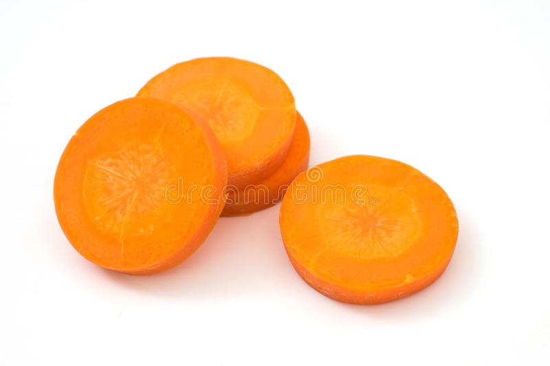Carrot slice isolated. On white background royalty free stock photography
