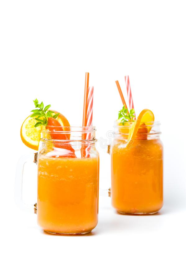 Carrot smoothie in a jar isolated. Healthy carrot and orange smoothie in a jar isolated royalty free stock photo