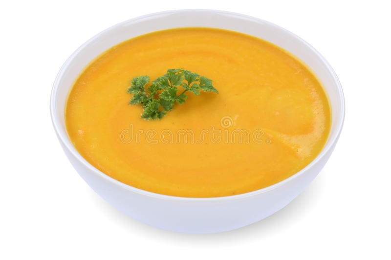 Carrot soup with carrots in bowl isolated. Carrot soup meal with carrots in bowl isolated on a white background royalty free stock images