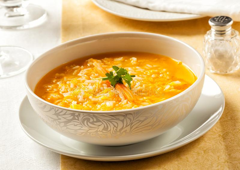 Carrot soup prepared with rice royalty free stock images