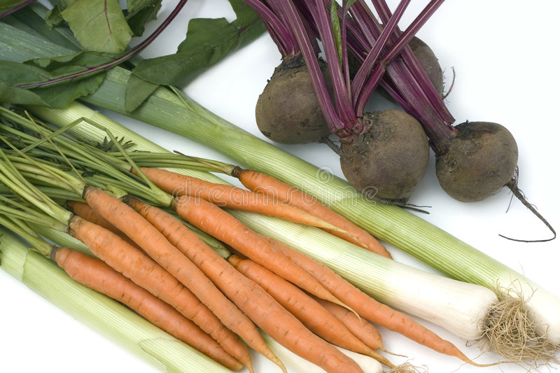 Carrots, beetroots and leek stock images
