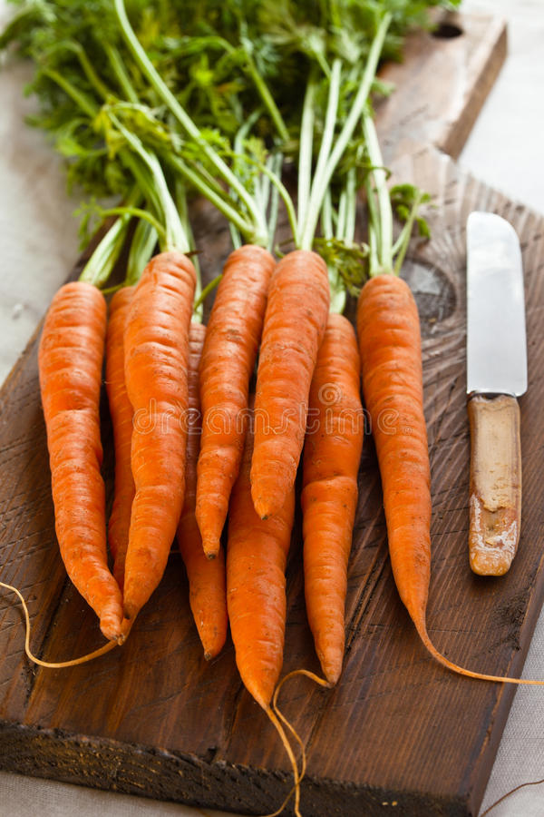Download Carrots On A Chopping Board Stock Photography - Image: 15654672