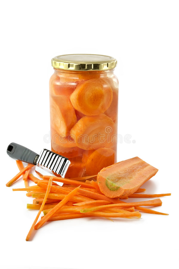 Carrots in glass container stock images