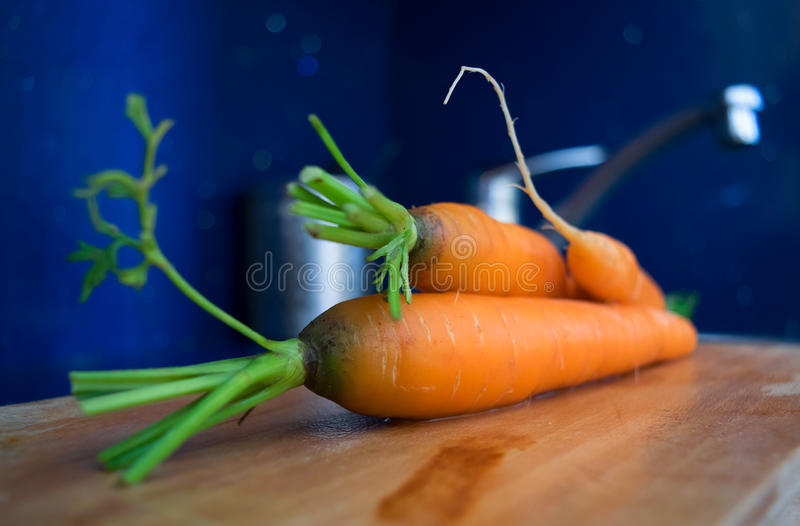 Carrots in a kitchen stock photos