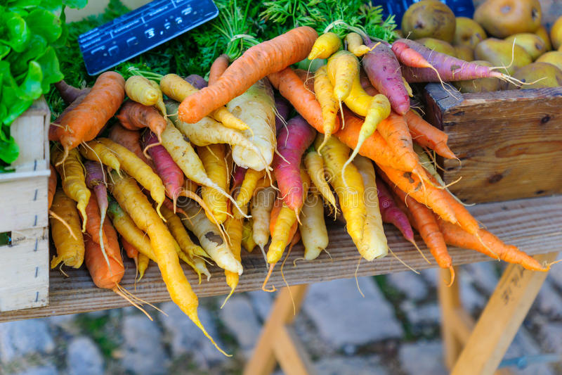 Carrots on sale in a French market. Various carrots on sale in a French market, in Noyers-sur-Serein, Burgundy, France royalty free stock images