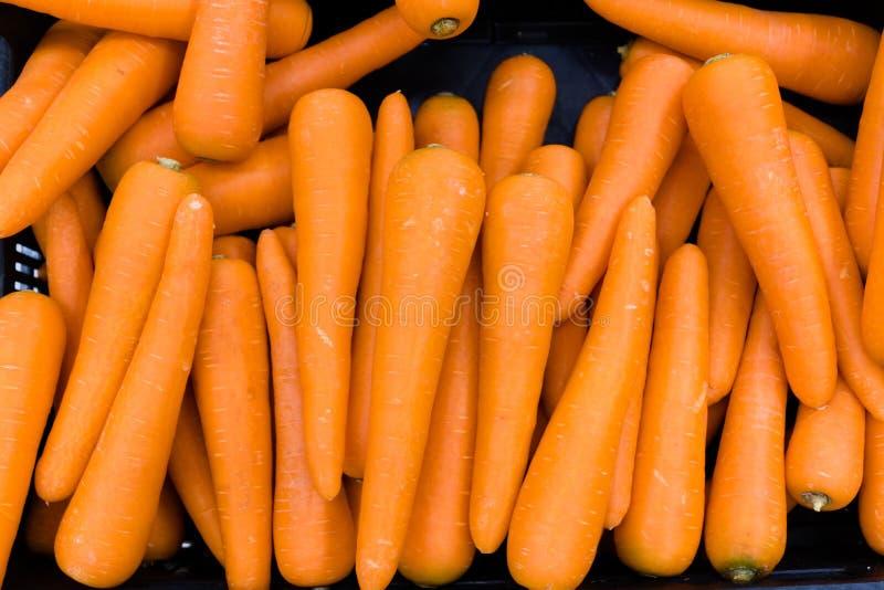 Carrots for sale. At hypermarket, product, vegetable, store, nobody, retail, supermarket, food, shop, garden, diet, search, abundance, orange, display stock photo