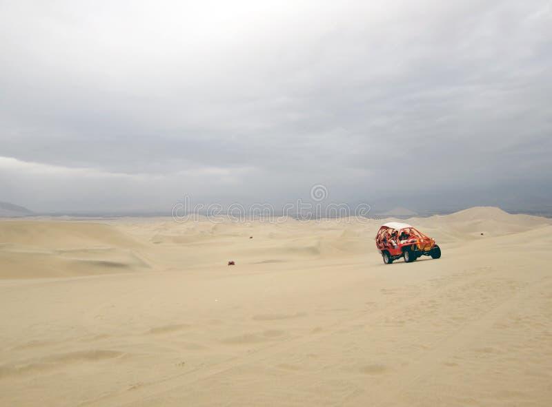 Carrozzini di duna e sandboarding immagini stock libere da diritti