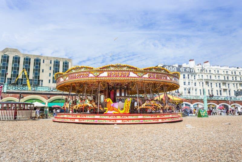 Carrusel en la 'promenade' de la playa de Brighton foto de archivo libre de regalías