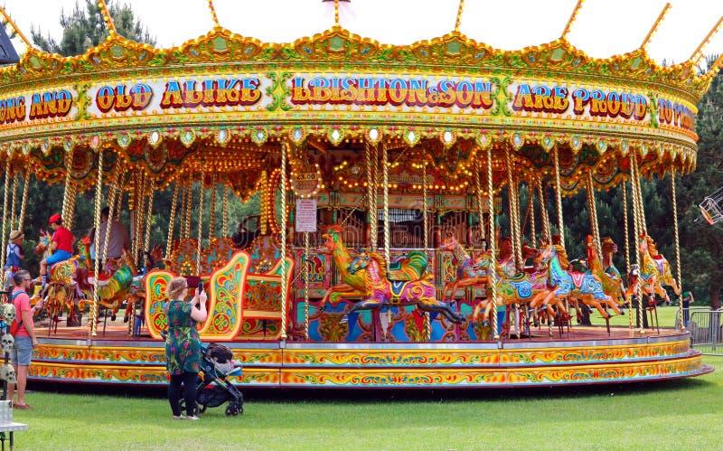 Carrusel en un carnaval o una feria imagenes de archivo