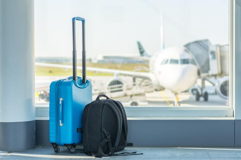 Carry-on in front of a plane royalty free stock photos