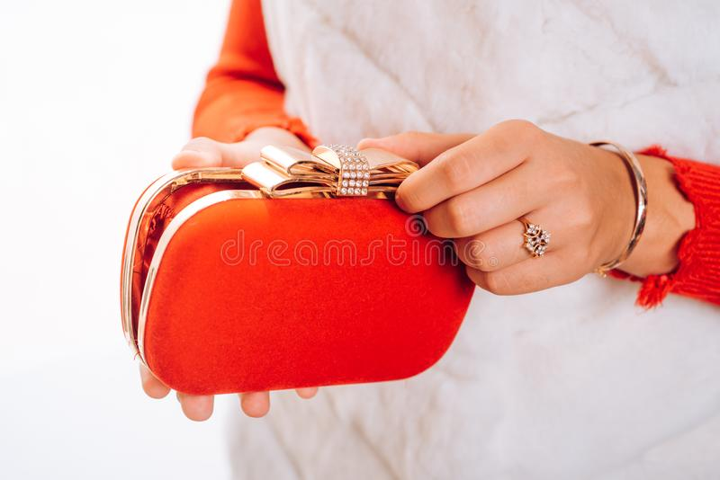 Carry your lippy in style. Mini bag. Fashion handbag. Fashion accessory. Vintage or retro clutch design. Red purse or stock images