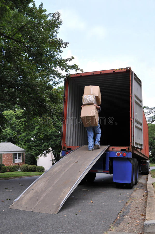 carrying boxes into moving truck royalty free stock photos image 20256528. Black Bedroom Furniture Sets. Home Design Ideas