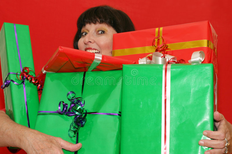Carrying gifts stock photos