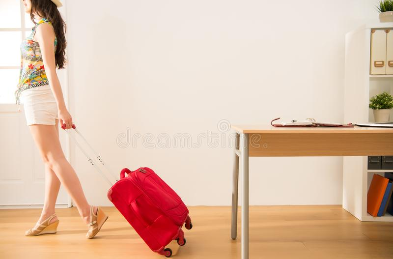 Carrying her suitcase ready to go for vacation royalty free stock photography