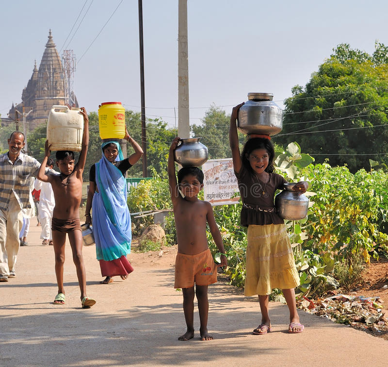 Carrying jugs of water in India