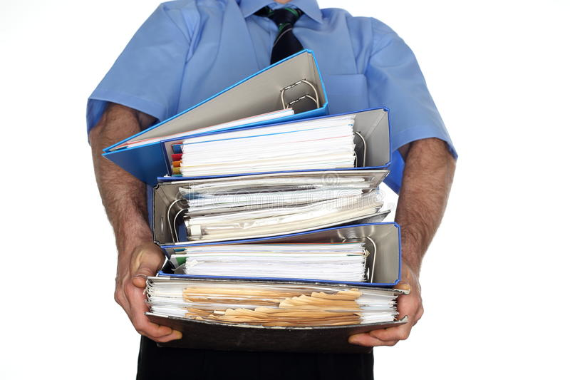 Carrying many file foldersschleppen stock image