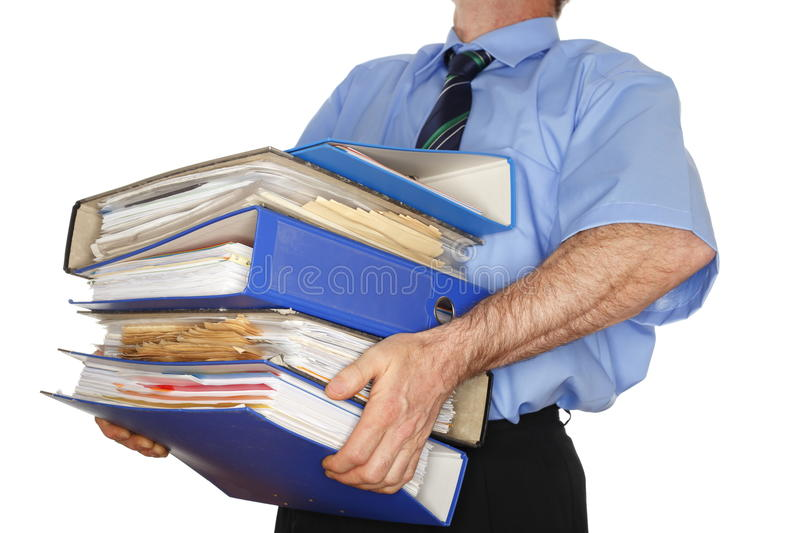 Carrying many folders stock images