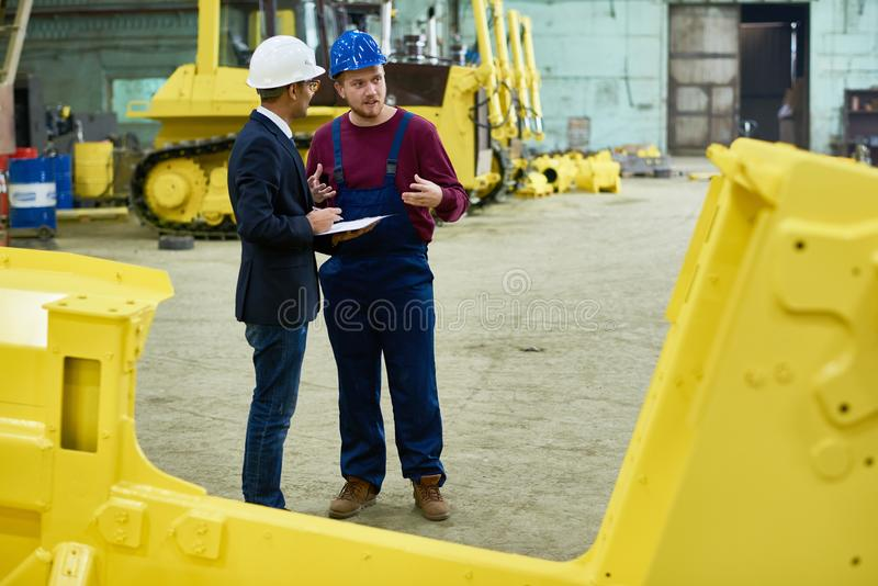 Carrying out inspection in heavy equipment factory stock images