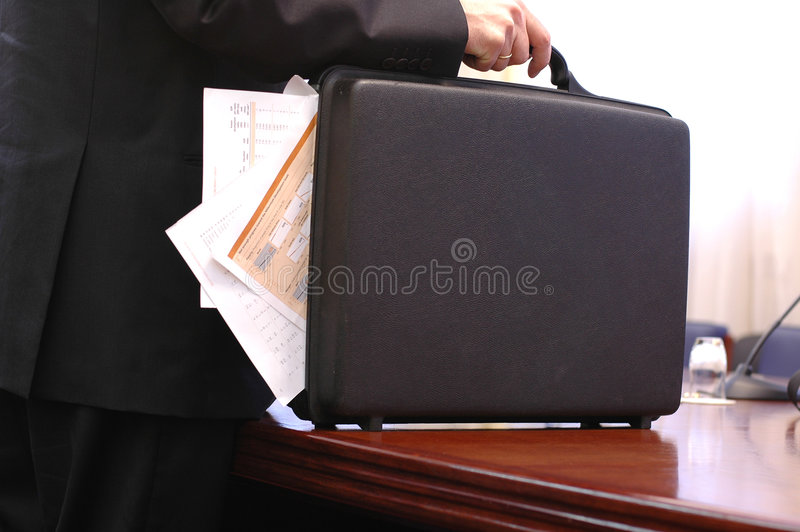 Carrying  Overloaded Briefcase Royalty Free Stock Images