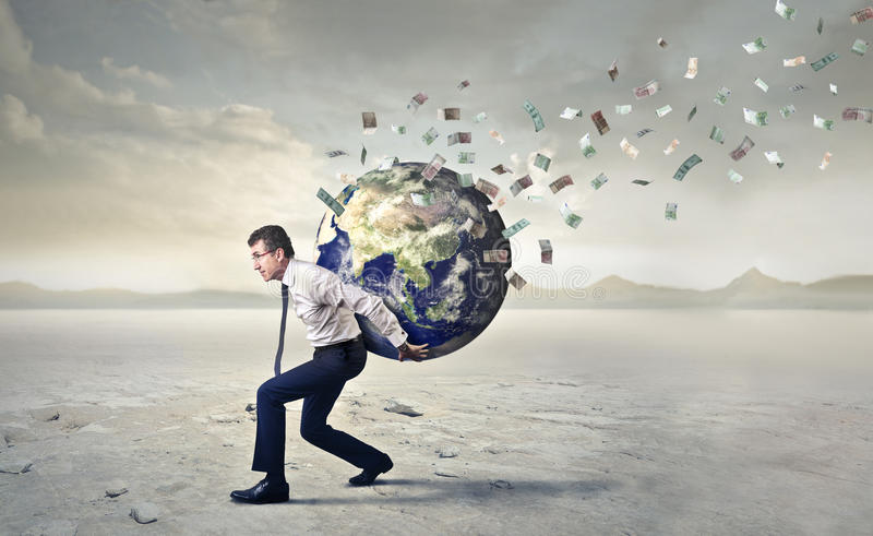 Carrying the whole world. Businessman carrying the whole world on his shoulders stock images