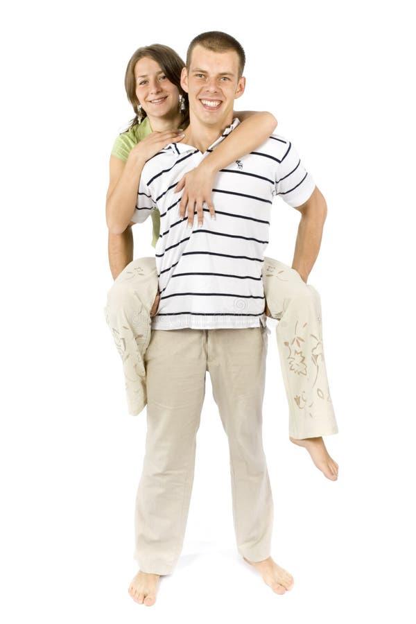 Carrys do noivo seu sobreposto da amiga imagens de stock royalty free