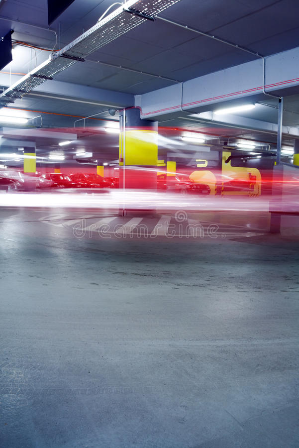 Cars In Abstract Underground Parking Garage Stock Photography