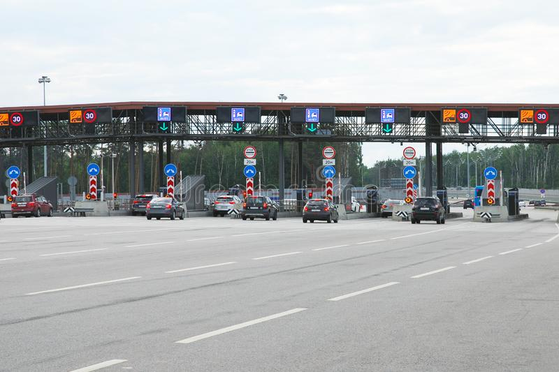 Cars aproaching toll road entry pin on a highway stock image
